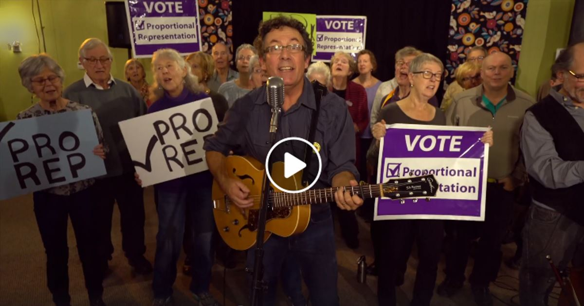 Tony Turner and group singing fair voting song.